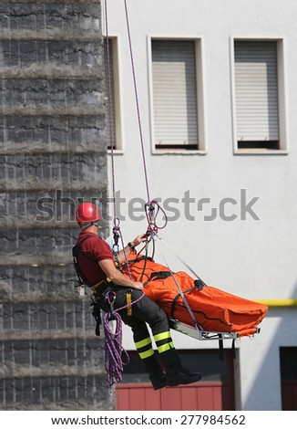 Fireman  carries the stretcher with the dummy - stock photo