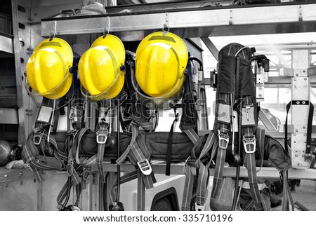 Fireman Hat in Fire Truck rescue. - stock photo