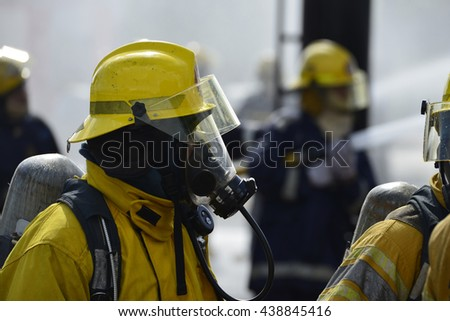 Fireman in action while wearing a fire suit.