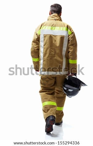 Fireman in uniform on a white background - stock photo
