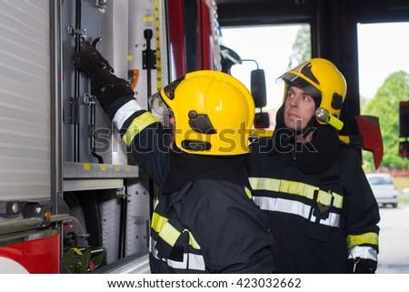 Fireman on duty,under exposed photo - stock photo