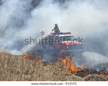 Fireman putting out fire - stock photo