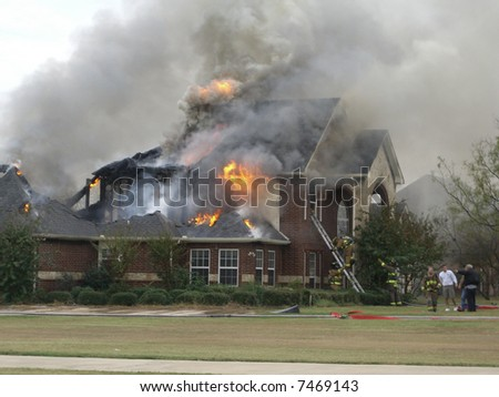 Fireman responding to house fire