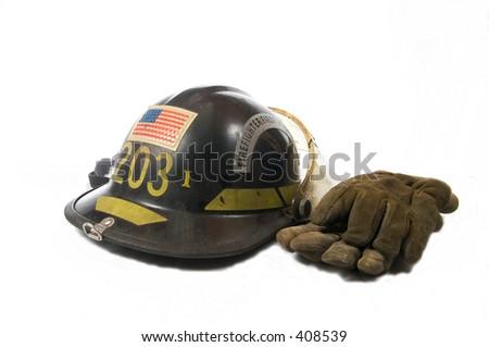 fireman's helmet and gloves - stock photo