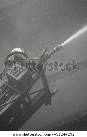 fireman wearing a gas mask on the stairs