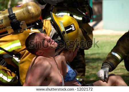 Firemen attend victim in terrorism drill - stock photo