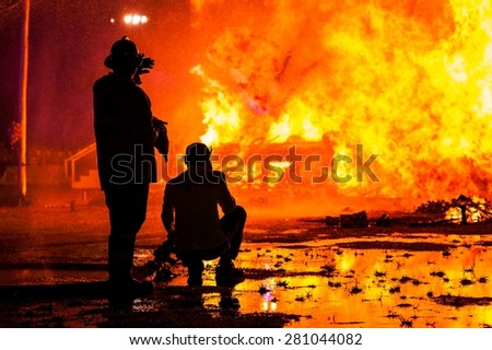 Firemen fighting  - stock photo