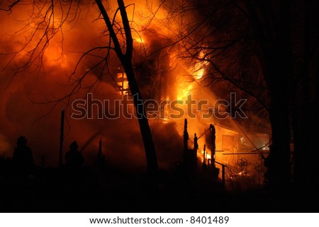 Firemen fighting a midnight fire in south west Detroit - stock photo