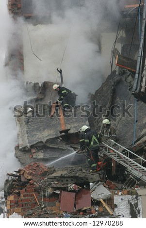 Firemen working after a gas explosion in an appartment house. - stock photo