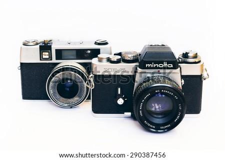 Firenze, IT - March 20, 2015: Vintage Minolta XE-5 reflex and Taron 50mm film camera. - stock photo