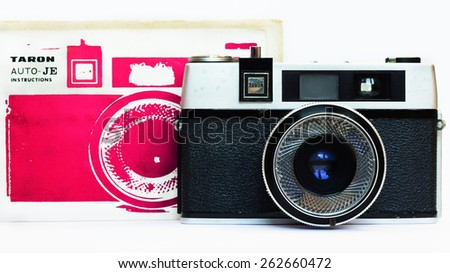 Firenze, IT - March 20, 2015: Vintage Taron 50mm film camera with instruction manual - stock photo