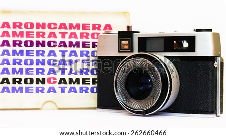 Firenze, IT - March 20, 2015: Vintage Taron 50mm film camera with original case - stock photo