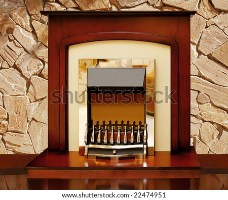 Fireplace against a stone wall - stock photo