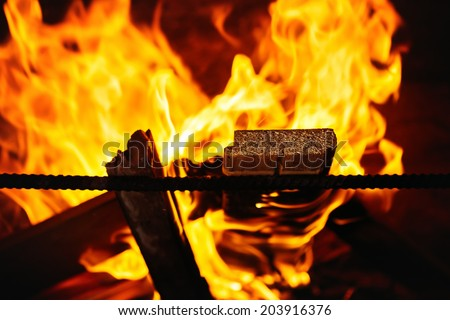 Fireplace close up background. Warm and cosy fire. Selective focus. - stock photo
