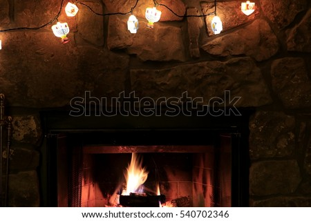 Fireplace decorated with a string of Hanukkah lights; Jewish holidays in the American Midwest