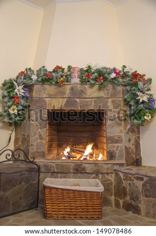 fireplace decorated with noel ornaments - stock photo
