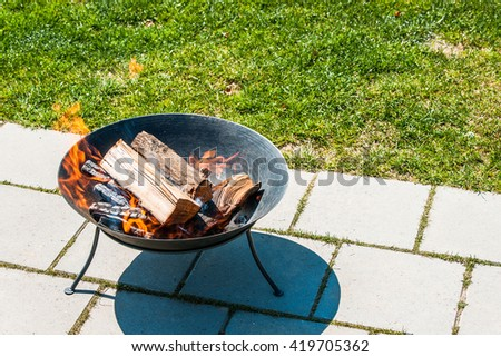 Fireplace in a garden terrace in the summer - stock photo