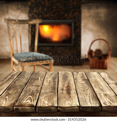 fireplace in room with wall and retro old chair of free space with dirty brown table of wood space