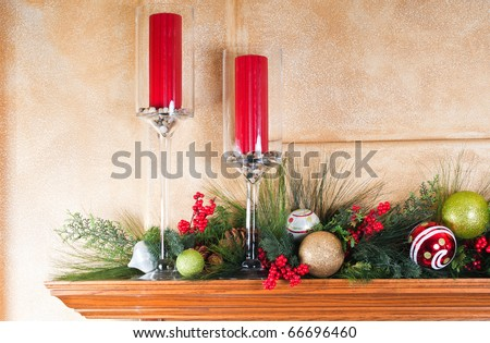 Fireplace mantle decorated with candles and garlands for Christmas - stock photo