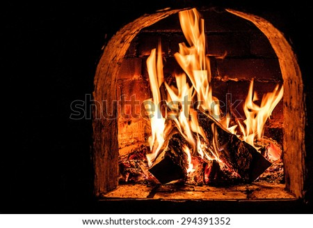 Fireplace with a blazing fire. Photo. - stock photo