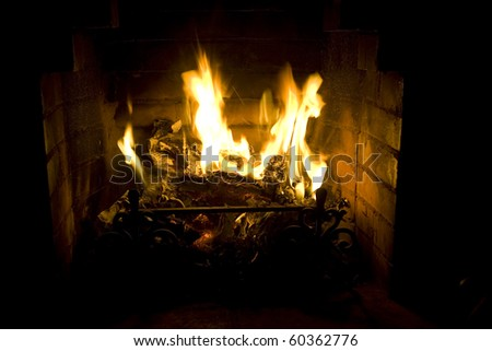 Fireplace with a burning fire - stock photo