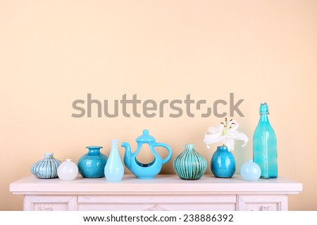 Fireplace with beautiful blue decorations in room  - stock photo