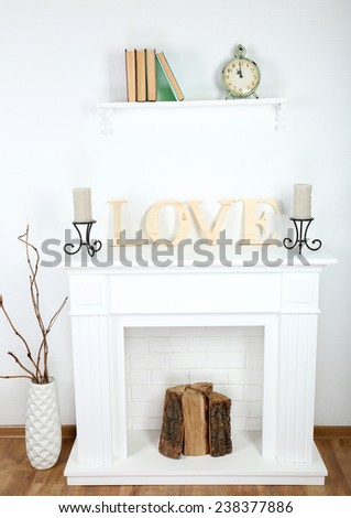 Fireplace with beautiful decorations in comfortable living room - stock photo