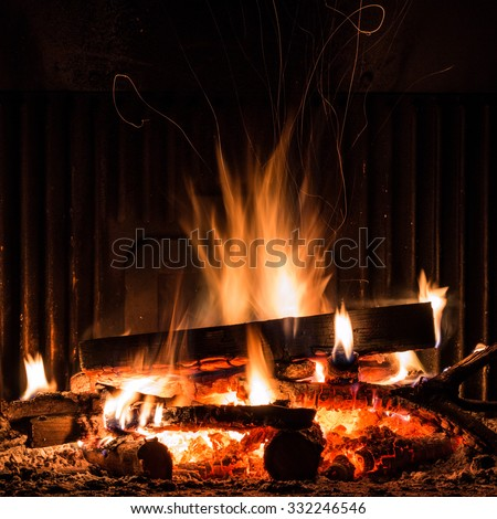 Fireplace with blazing flames, view of the fire - stock photo
