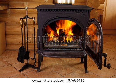 fireplace with flames at the house - stock photo