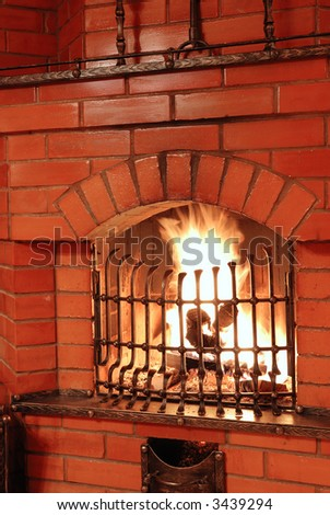Fireplace with some fire tools in country house