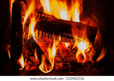 fireplace with wood and fire - stock photo