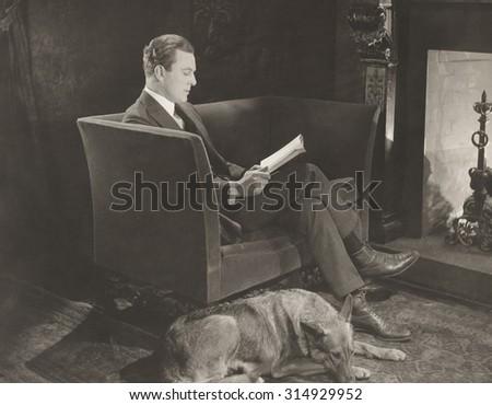 Fireside reading - stock photo