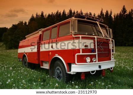 Firetruck in a meadow - stock photo