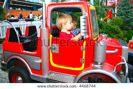 Firetruck in the entertainment park (with kids riding in it)