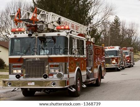 Firetrucks on the scene in a residential neighborhood - stock photo