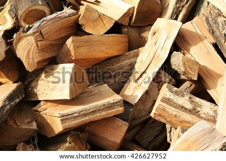 Firewood background - chopped firewood - stock photo