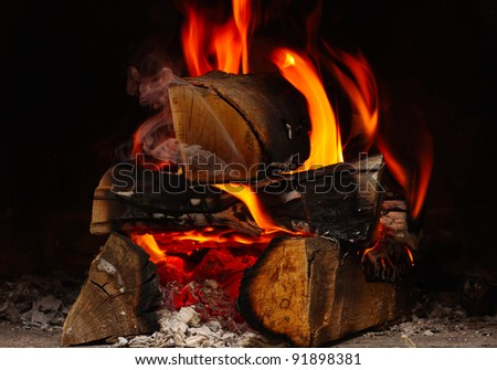 firewood burning at the fireplace close up - stock photo