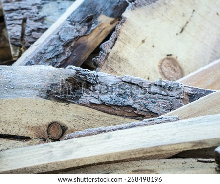 Firewood covered with frost  - stock photo