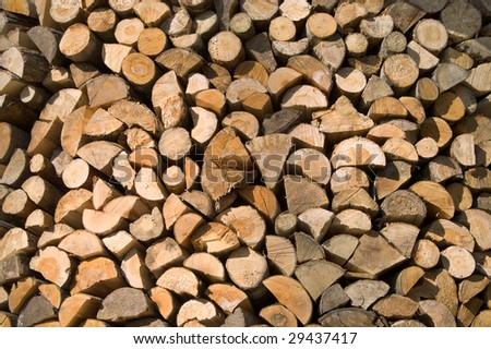 Firewood logs stacked up for winter fuel