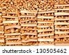 Firewood neatly settled - stock photo