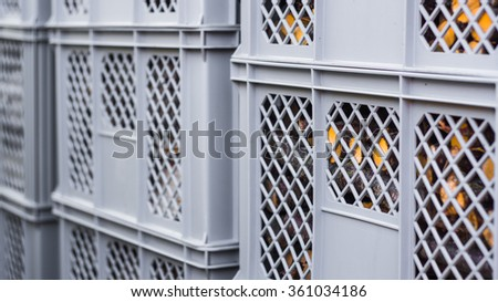Firewood stacked in plastic crates - stock photo
