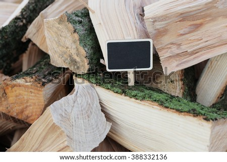 Firewood with black chalkboard. Wooden background. Shabby background. many wooden pieces. Save the planet.