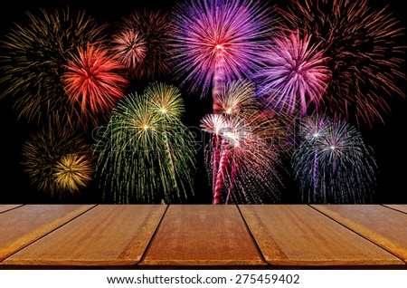 Firework celebration on dark background with Wood Table. - stock photo