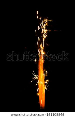 firework sparkler isolated on black - stock photo