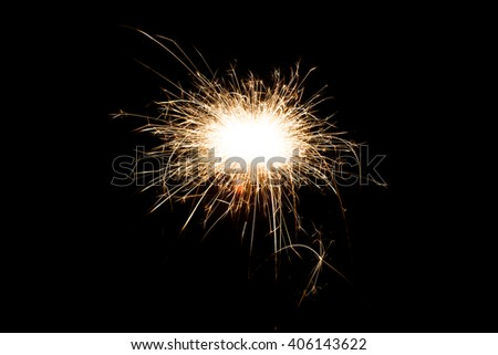 Firework Sparkler on black background, close-up - stock photo