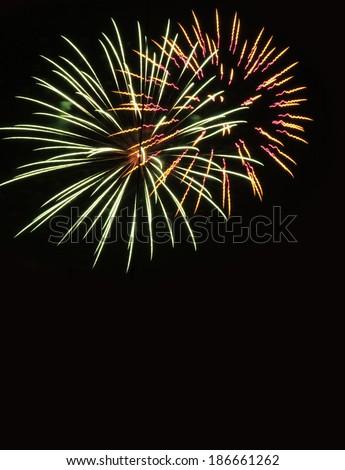 Firework streaks in the night sky  - stock photo