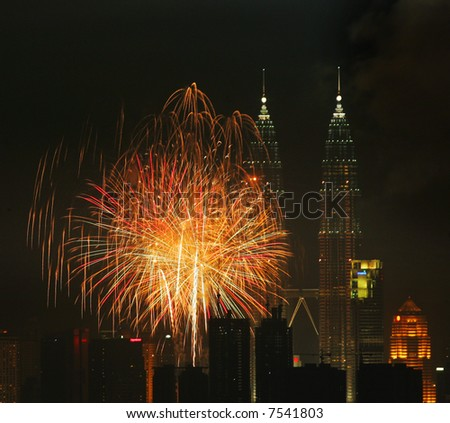 Fireworks above Malaysia's landmark Petronas Twin Towers. - stock photo