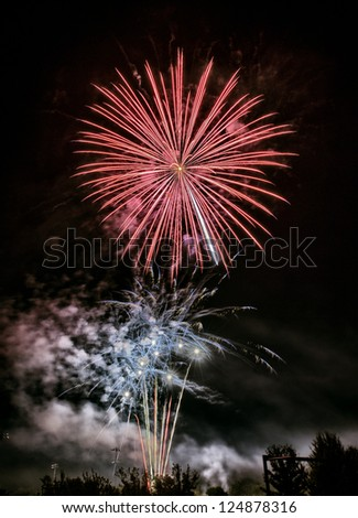 fireworks at night, red flower exploding on the sky, happy new year - stock photo