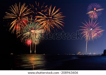 Fireworks at sea and beach various colors  - stock photo
