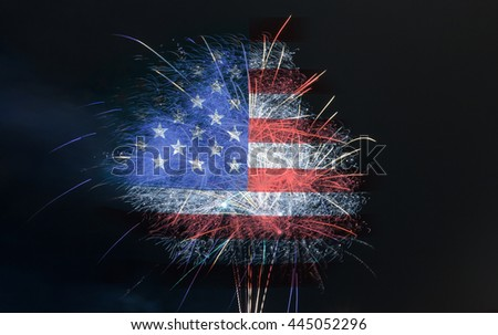 Fireworks burst on holiday or celebration. American flag in background